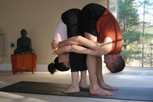 double standing forward bend yoga position