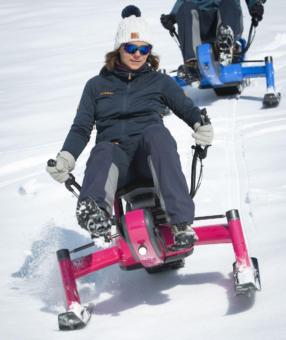 A women riding Arosno E-trace Electric snow bike